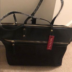 Black tote with multiple pockets and zippers